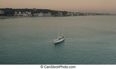 Aerial view of a moving sailboat near Nettuno in the...