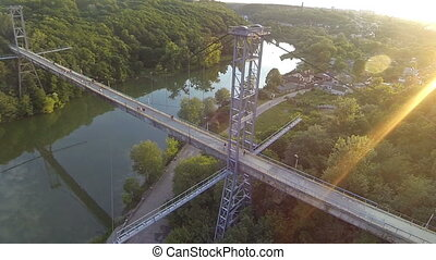 Aerial view of a pedestrian bridge across the river