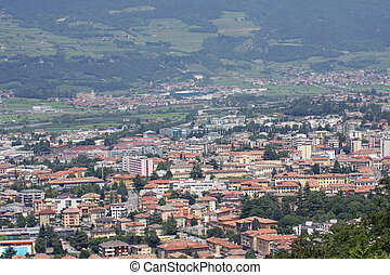 Aerial view of a populous city with many houses and shop