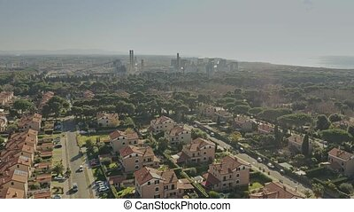 Aerial view of a residential area against air polluting...