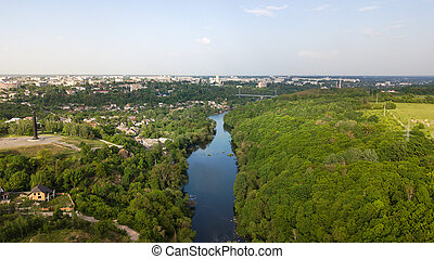 Aerial view of a river with trees and houses on the shore