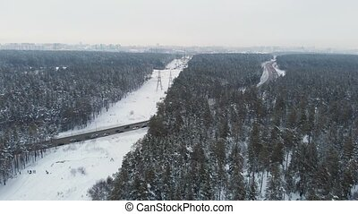 Aerial view of a road in winter landscape