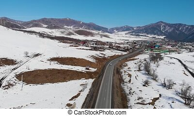 road in winter landscape - Aerial view of a road in winter...