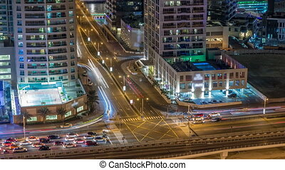 Aerial view of a road intersection in a big city night...