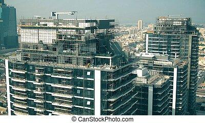 Aerial view of a skyscraper construction site details. Dubai, UAE