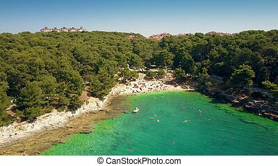 Aerial view of a small Croatian beach resort in Pula on the Adriatic sea. Summer vacation time