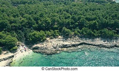 Aerial view of a small rocky beach on the Adriatic sea