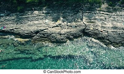 Aerial view of a small rocky beach on the Adriatic sea. Summer vacation time