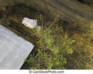 Aerial view of a small snow pile near a house