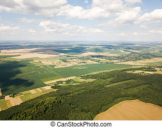 Aerial view of a small village among forests and fields