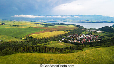 Aerial view of a small village in Slovakia with lake, in the Tatra Mountains