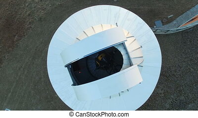 Aerial view of a telescope inside the dome of an astronomical observatory
