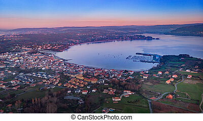 Aerial view of a town at the sunset