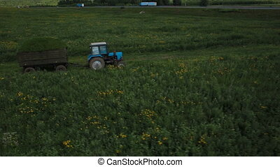 Aerial view of a tractor in field russia