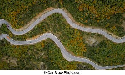 Aerial view of a traffic driving along a mountain road in Greece