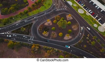 Aerial view of a traffic in downtown Los Cristianos on Tenerife, Canary Islands, Spain. Accelerated video