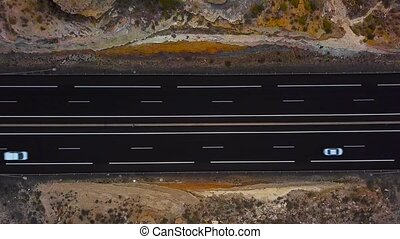 Aerial view of a truck and other traffic driving along a highway on Tenerife, Canary Islands, Spain. Accelerated video