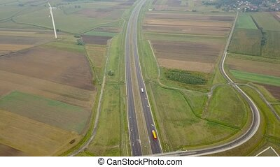 Aerial view of a truck and other traffic driving along a highway in Poland