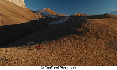 Aerial view of a two girls traveler with backpacks and...
