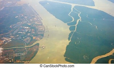 Aerial View of a Verdant Delta on a Navigable River - FullHD...