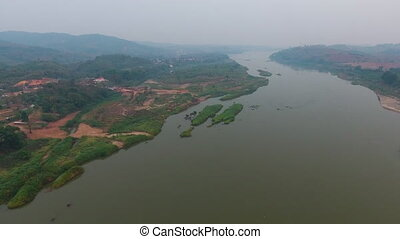 Aerial View of a winding river - An aerial shot of a land...