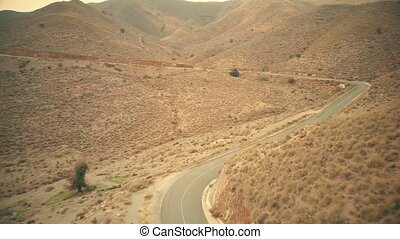Aerial view of a windy car road in mountains - Aerial shot...