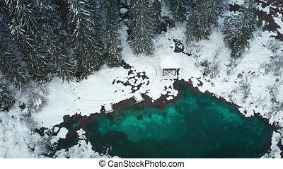 Aerial crane shot of snowy winter lake Zelenci at Kranjska gora, Slovenia