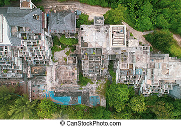 Aerial view of abandoned hotel on the tropical island