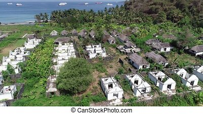 Aerial view of abandoned houses on tropical island of Bali
