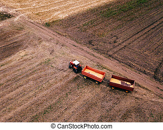 Aerial view of agricultural tractor in the field
