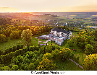 Aerial view of aincient Castle. Sunset over summer park