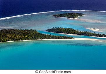 AITUTAKI - SEP 16:Aerial view of One foot island, Tekopua island and Motukitiu Island on Sep 16 2013.Polynesians first settled Aitutaki around AD 900.