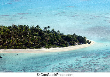 """AITUTAKI - SEP 16:Aerial view of Rapota island in Aitutaki Lagoon, Cook Islands on Sep 16 2013.It was the location for series 13 of the popular US reality TV show, """"Survivor""""."""
