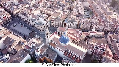 view of Alcoi cityscape with blue dome of Archpriest church ...