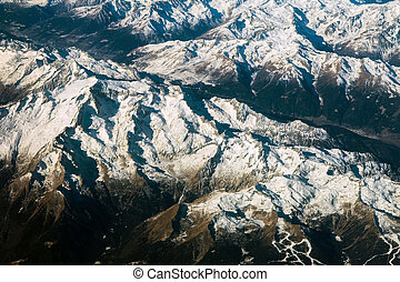 Aerial view of alps mountains covered with snow