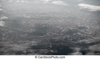 Aerial View of an Asian Metropolitan City. 1080p DCI footage...