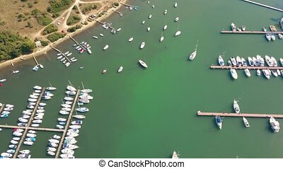 Aerial view of anchored boats, motorboats and sailboats at...