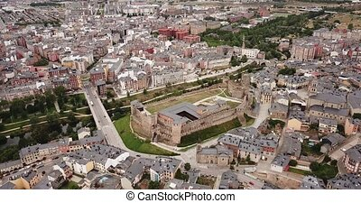 Aerial view of ancient Templar castle in small Spanish city of Ponferrada on background of modern cityscape