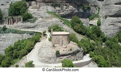 Aerial view of ancient temple on cliff top - Drone flight...