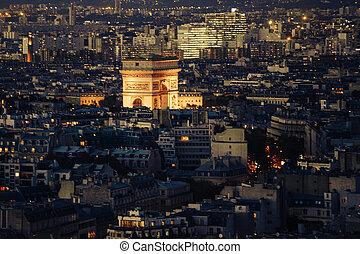 Aerial view of Arc de Triomphe de l'Etoile (The Triumphal Arch) in Paris at night