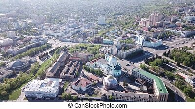 Scenic view from drone of historic center of old Russian town of Kursk with Znamensky Cathedral and Resurrection Church during restoration