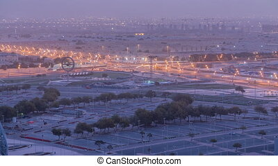 Aerial view of Aspire Zone from top night to day timelapse...