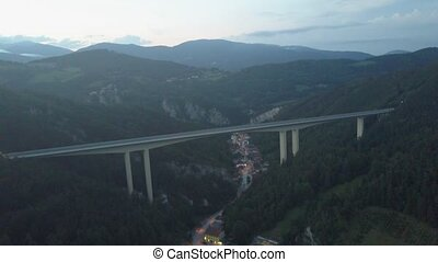 Aerial view of Austrian highway bridge above small town in the evening