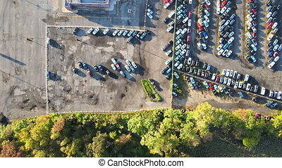 Aerial view of auto auction many used car lot parked ...
