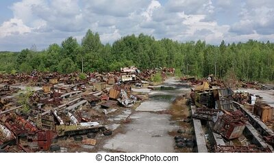 Aerial view of auto junkyard in Chernobyl zone - Drone view...