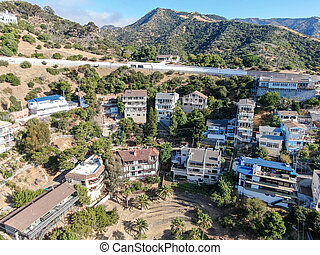 Aerial view of Avalon downtown with their houses on the cliff in Santa Catalina Island, USA