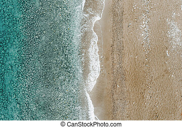 Aerial view of azure ocean and sandy beach