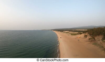Aerial view of Baikal shore. Drone flies above the sandy...
