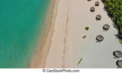 Aerial view of beautiful beach with straw umbrellas, Mauritius