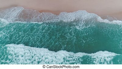 Aerial view of beautiful beach with waves crashing - Aerial...
